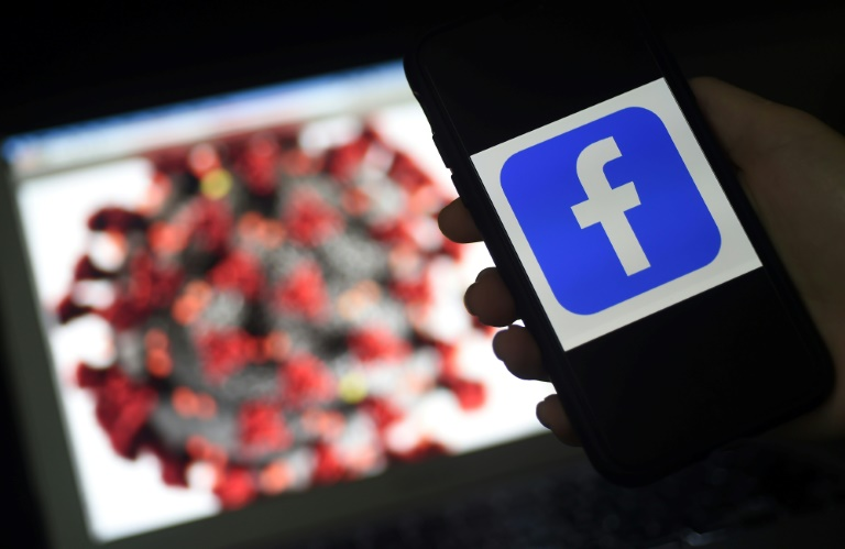 Facebook surges on user growth in pandemic, sees murky outlook