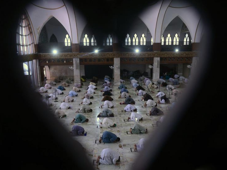 People pray at mosques during Ramadan in Lahore, Pakistan
