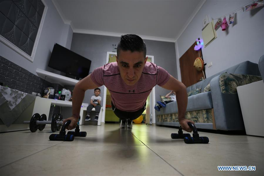 Fitness trainer display exercise at home during lockdown in Jerusalem