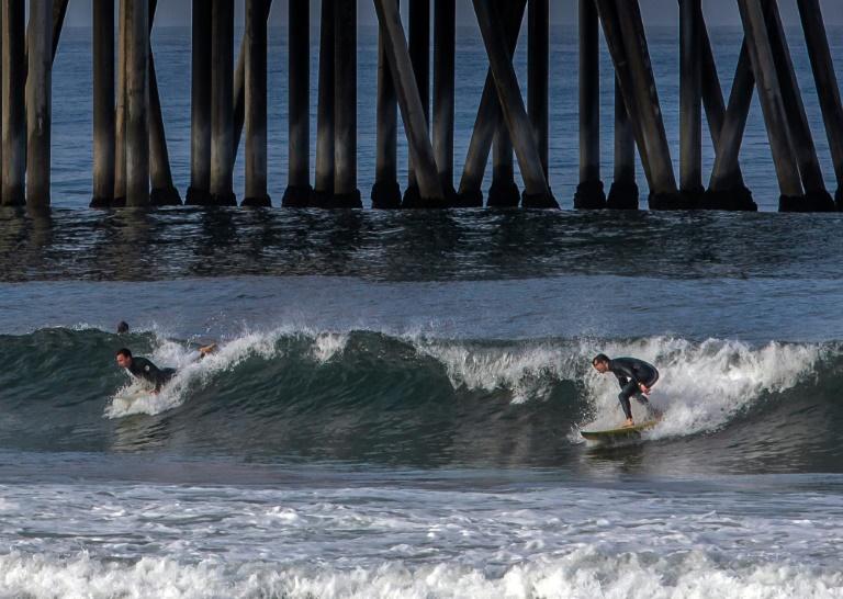 Surfers, sunbathers test waters as California closes Huntington Beach