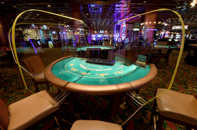 Las Vegas torn by virus as casinos clamor to reopen