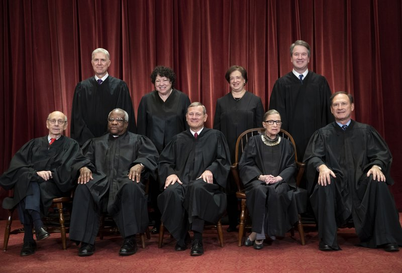 Justices smooth operators in phone arguments