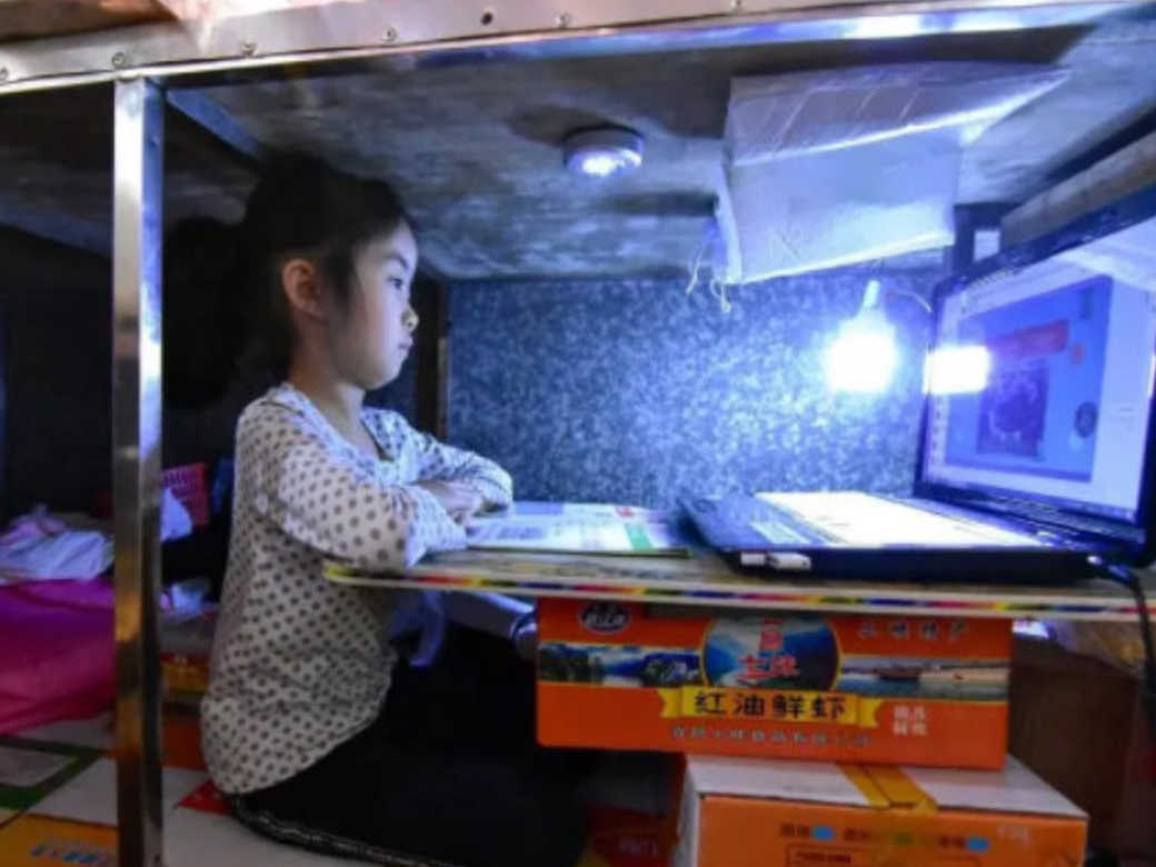 7-year-old girl goes trending on social media for studying under food stand