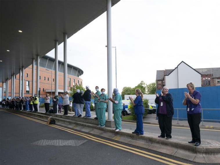 """People participate in weekly """"Clap for Our Carers"""" in Manchester, Britain"""