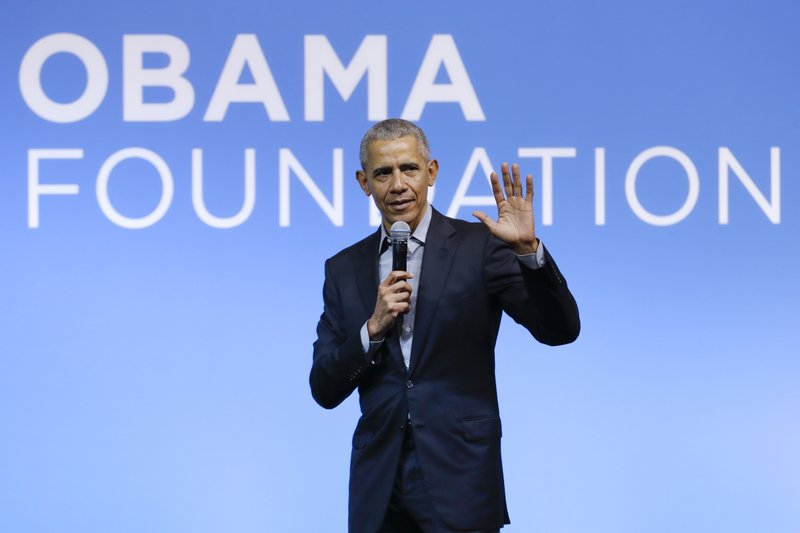 Obama lashes out at Trump in call with supporters