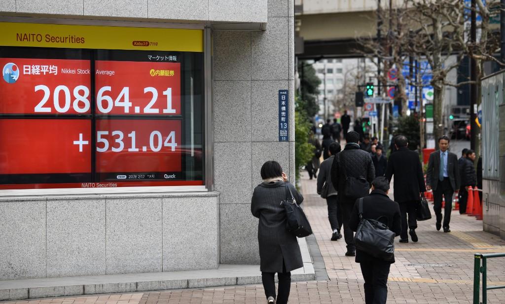 Tokyo stocks close higher on virus hopes in Japan