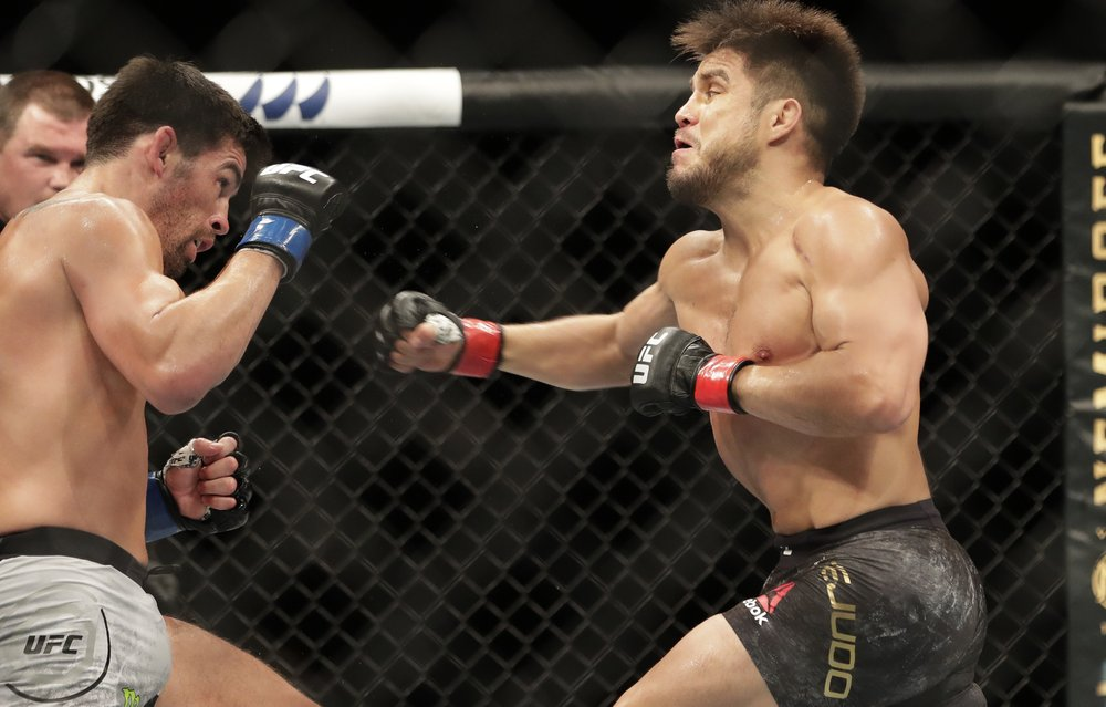UFC 249 ushers in fan-free, mask-filled era of sports