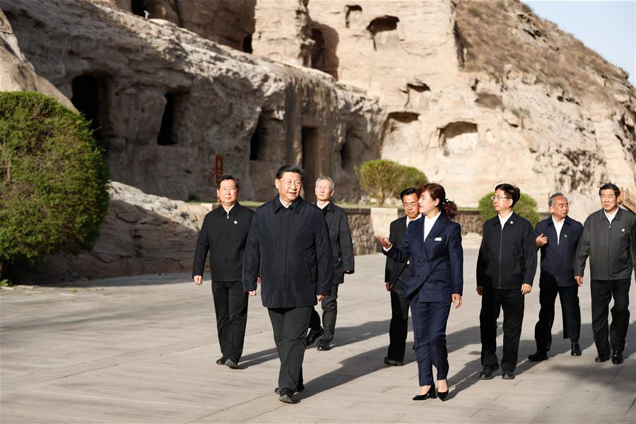 Xi stresses protection of Yungang Grottoes