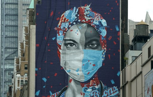 A mural honoring healthcare workers at Montefiore Medical Center in the Bronx is seen on the side of a building in Midtown Manhattan May 11, 2020 in New York..jpg