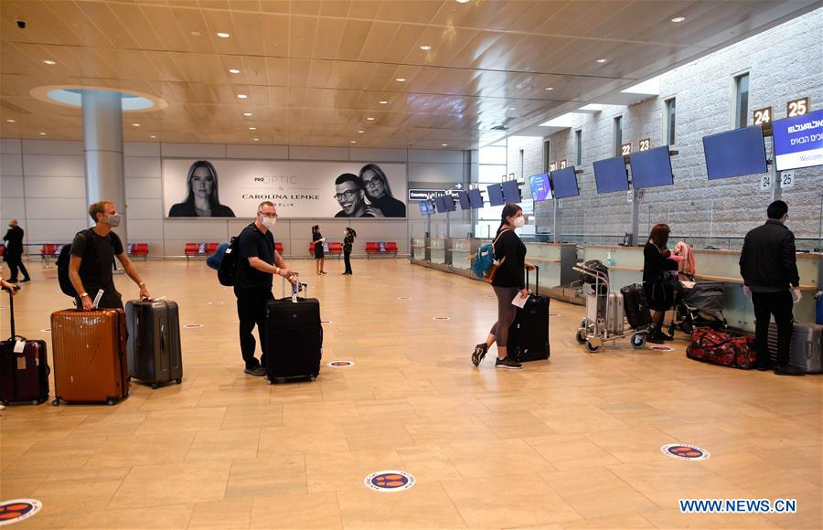 Passengers keep social distance in Ben Gurion International Airport, Israel