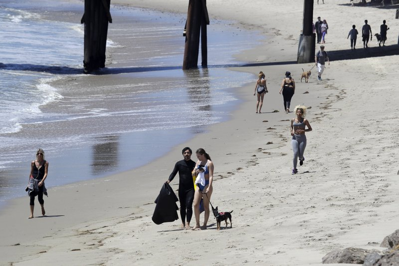 Surf's up and so are new beach rules to prevent virus spread