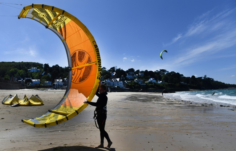 Beaches and football as Europe relaxes virus restrictions
