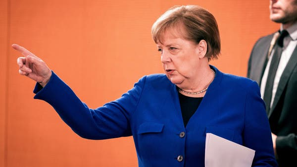 Mock tombstone placed at Merkel's electoral office