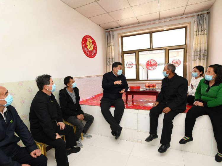 Small area of 'kang' shows Xi's concern for the people