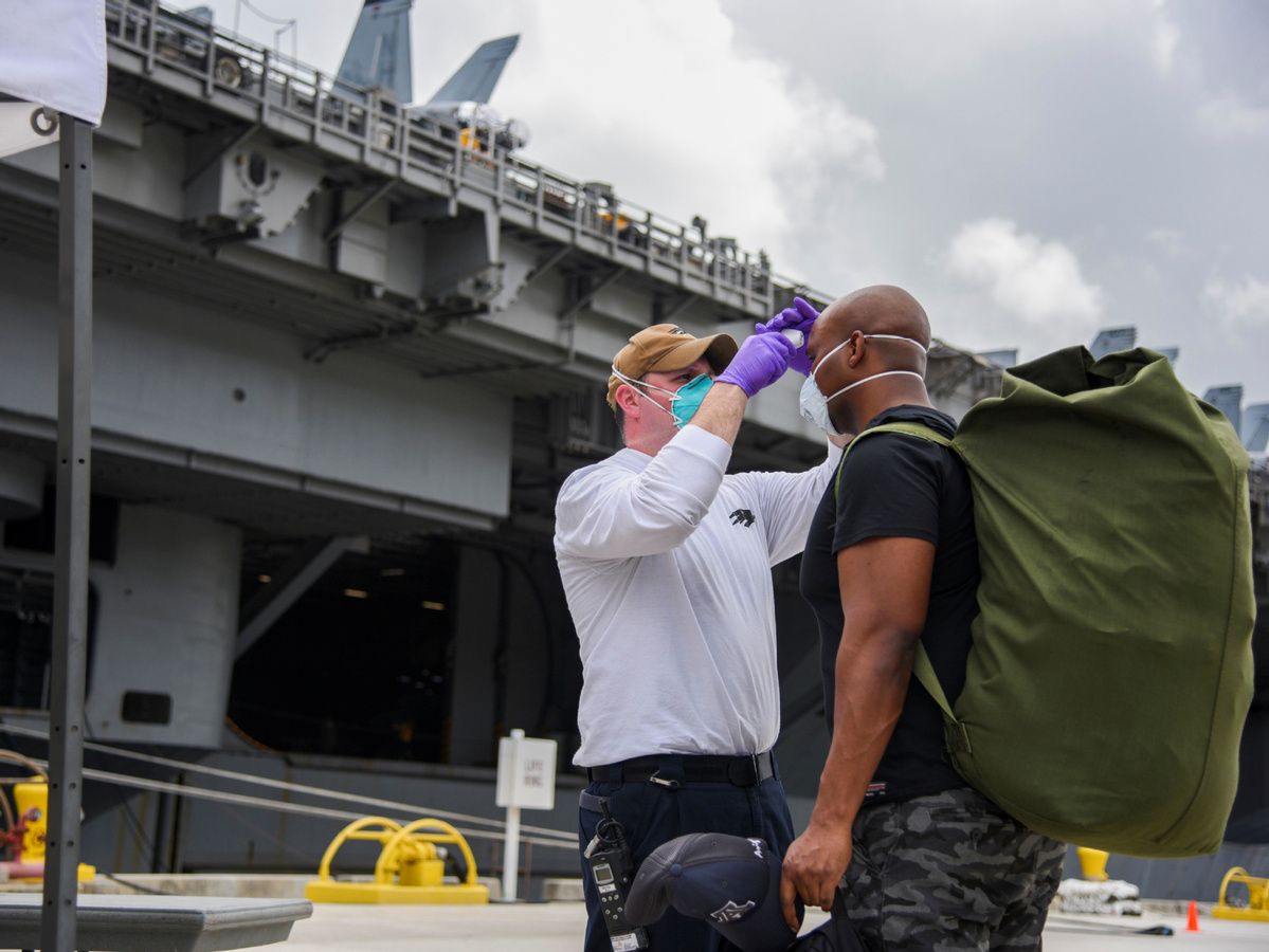Five sailors returning to US aircraft carrier test positive for coronavirus again