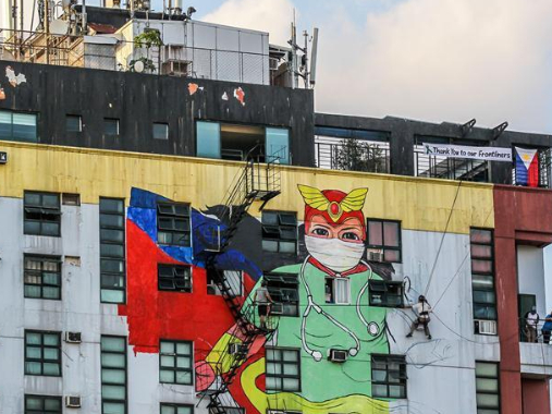 "Artists paint mural of ""Darna"" on building in Manila, the Philippines"