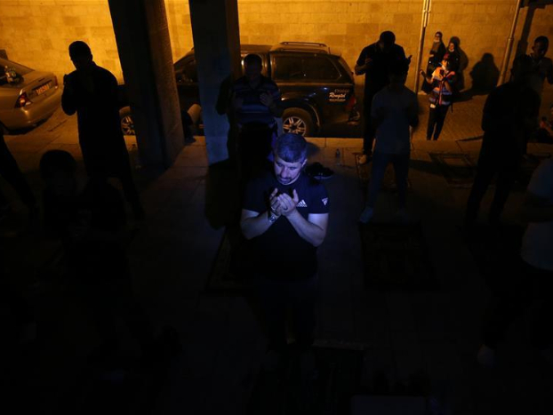 Muslim worshippers attend Laylat al-Qadr night prayer in Old City of Jerusalem