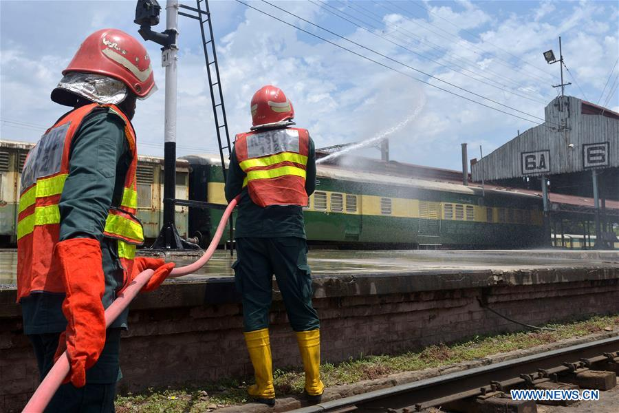Workers disinfect railway station in eastern Pakistan's Lahore