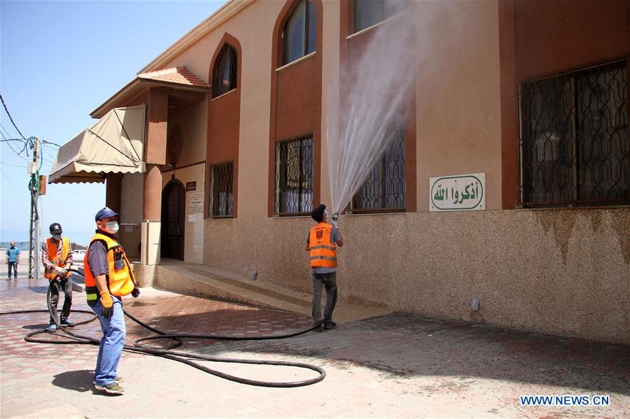Palestinian employees sterilize mosque in Gaza City