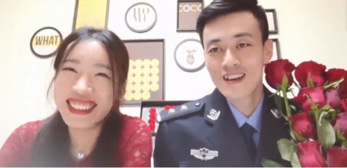 Online group wedding held for COVID-19 fighting couples on China's 'I love you' day