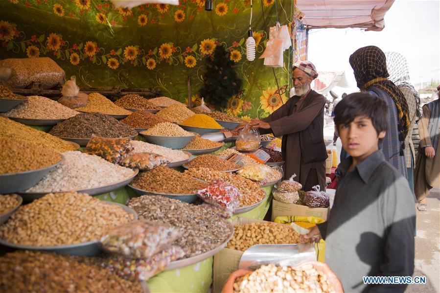 Afghans buy dry fruits ahead of Eid al-Fitr festival in Herat