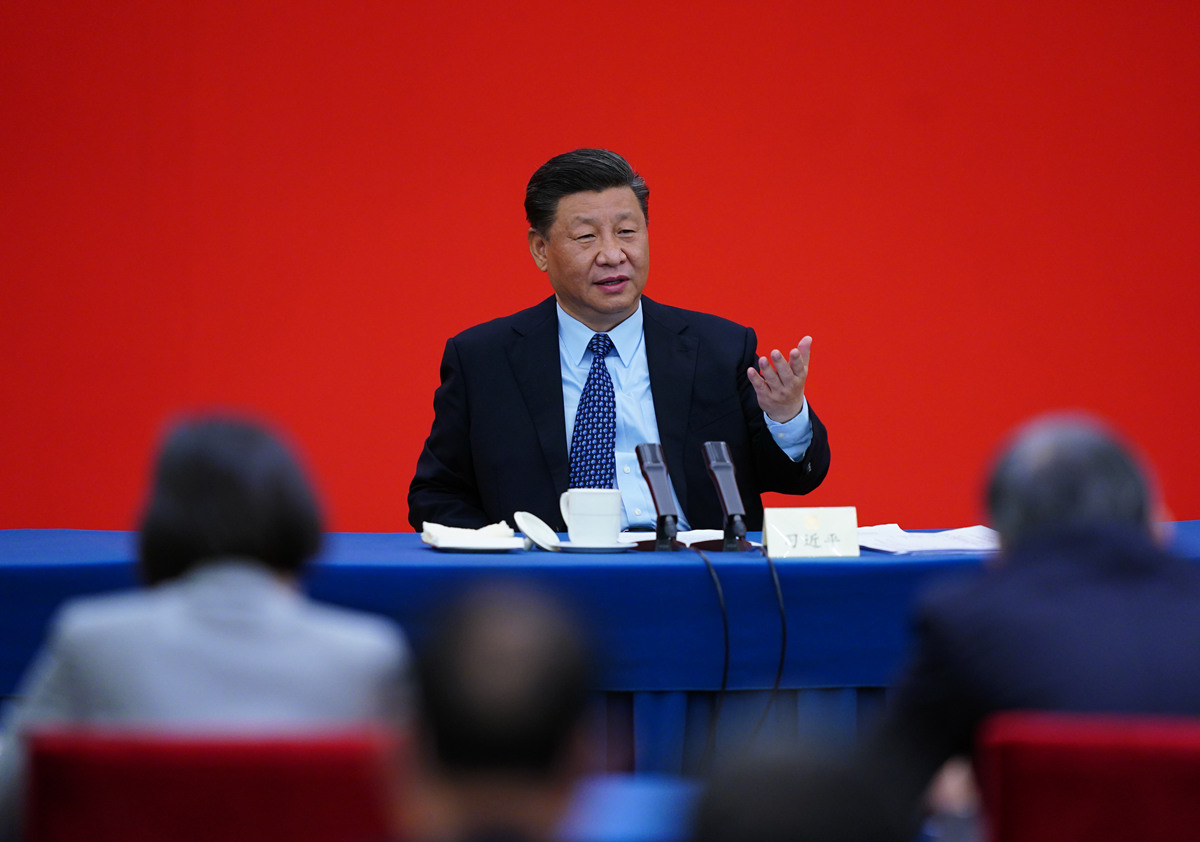 Xi visits political advisors, joins discussion at annual session