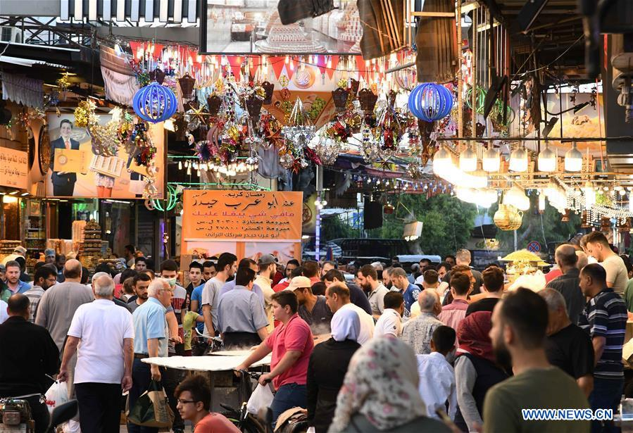 People do shopping in market for Eid al-Fitr in Damascus, Syria