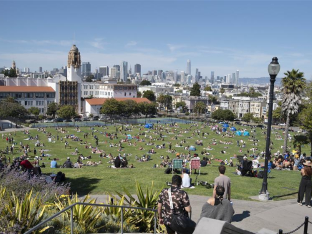 People sit separately in circled-off areas to assure social distancing in San Francisco