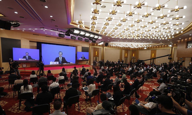 How diplomats work hard to defend China's interests, promote cooperation amid pandemic