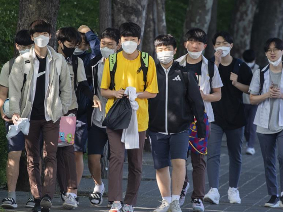 Students return to school for classes in Seoul, S. Korea