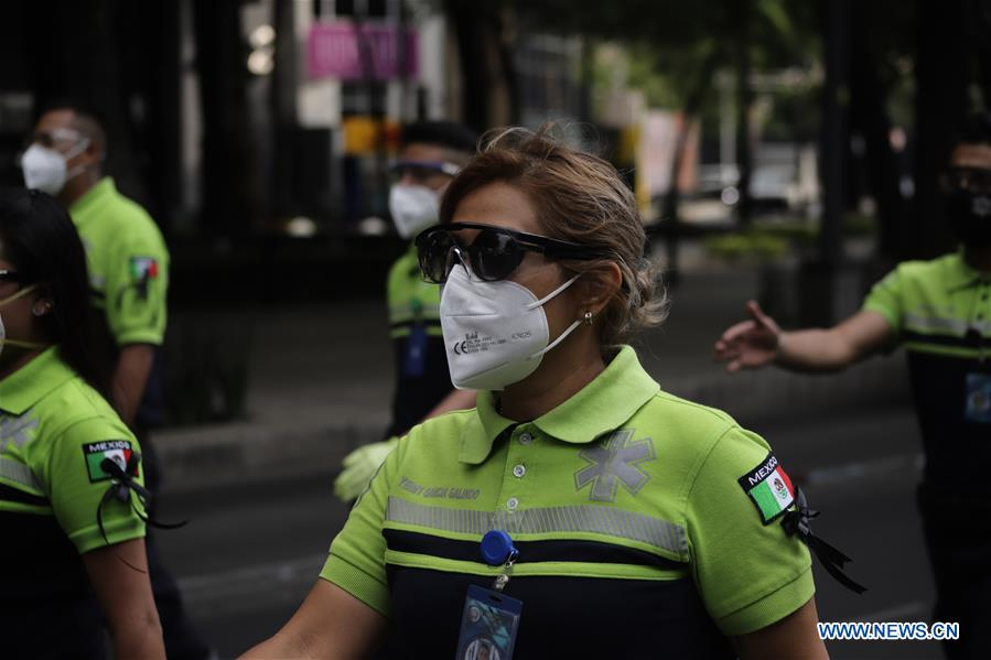 Paramedics take part in parade to commemorate medical personnel died in Mexico City