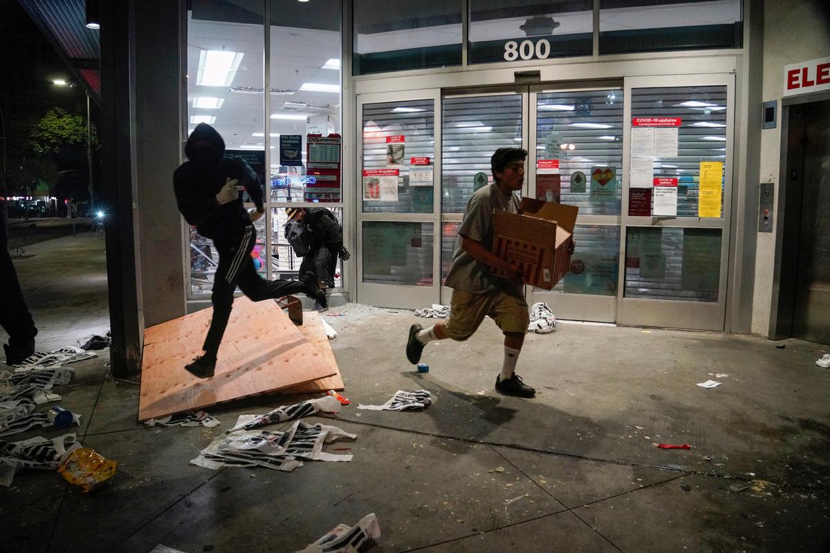 LA declares state of emergency as protests over killing of George Floyd turn violent