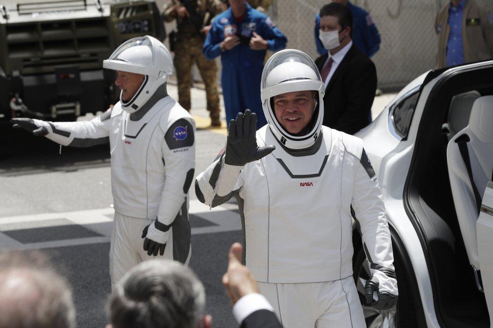 2 astronauts climb aboard SpaceX rocket for historic flight