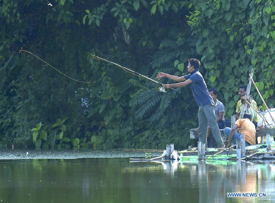 Anglers fish on opening day of fishing season in India
