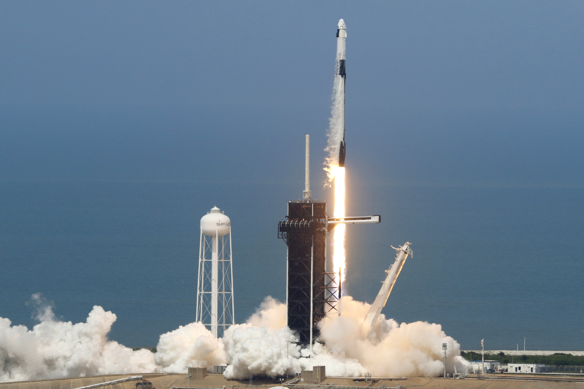 Historic liftoff sends astronauts to space station