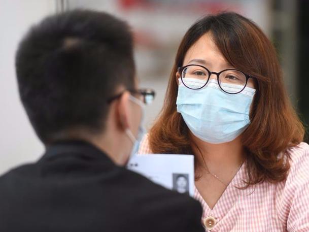 Wuhan holds first offline job fair since virus outbreak