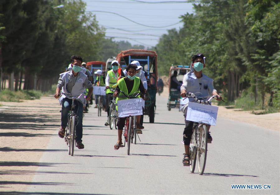 People participate in cycling event to mark World Environment Day in Afghanistan