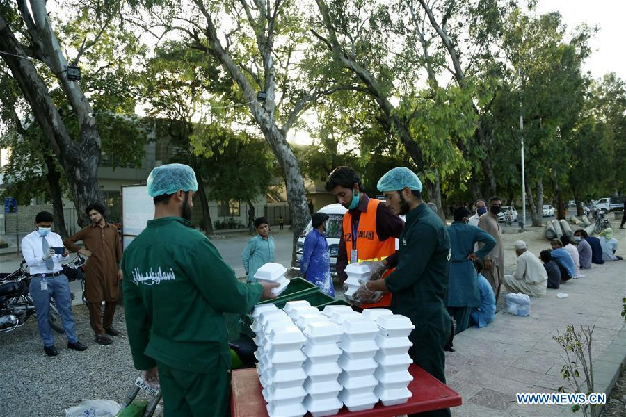Pakistani charity organization distributes food to people impacted by COVID-19