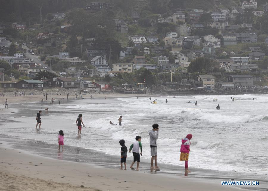 People have fun at Pacifica beach in San Mateo County, U.S.