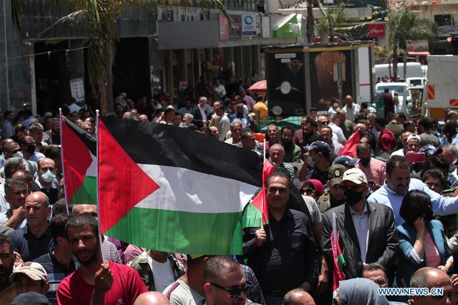 Palestinians protest against Israeli annexation plans in West Bank city of Nablus