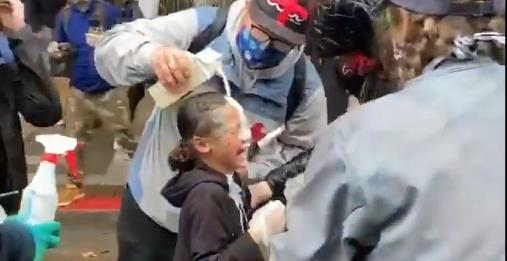 Girl screams in pain after 'police pepper-sprayed her' during Seattle George Floyd protest