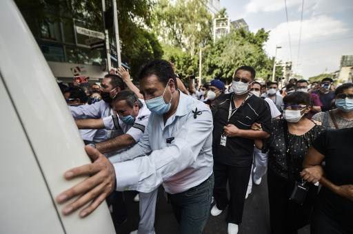 Mexico reports more than 1,000 virus deaths in a day for first time: official