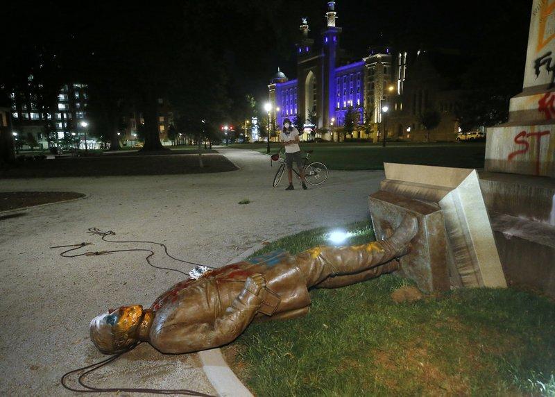 Protesters topple Confederate statue in Virginia capital
