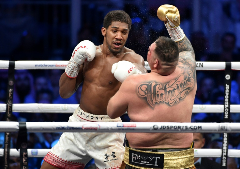 Heavyweight champion Joshua hits out at 'virus' of racism