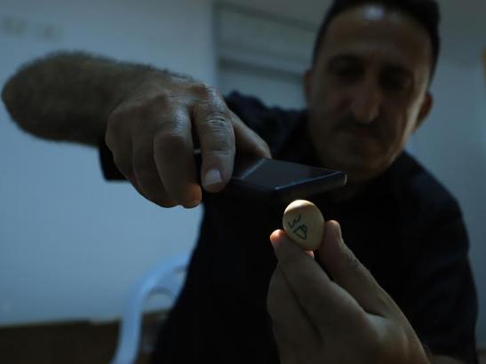 Palestinian man raises partridges to keep them from extinction