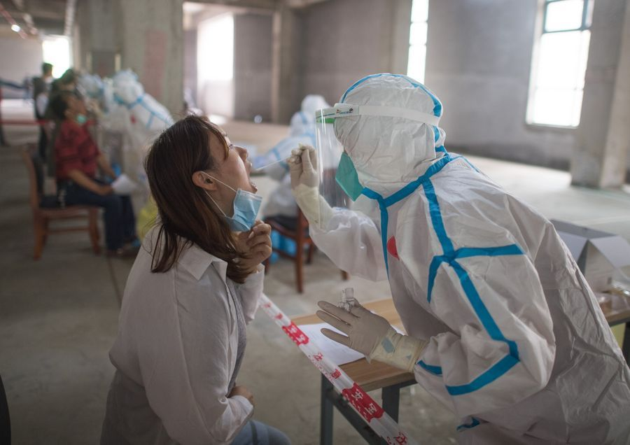 300 asymptomatic Wuhan cases 'not infectious', commission says