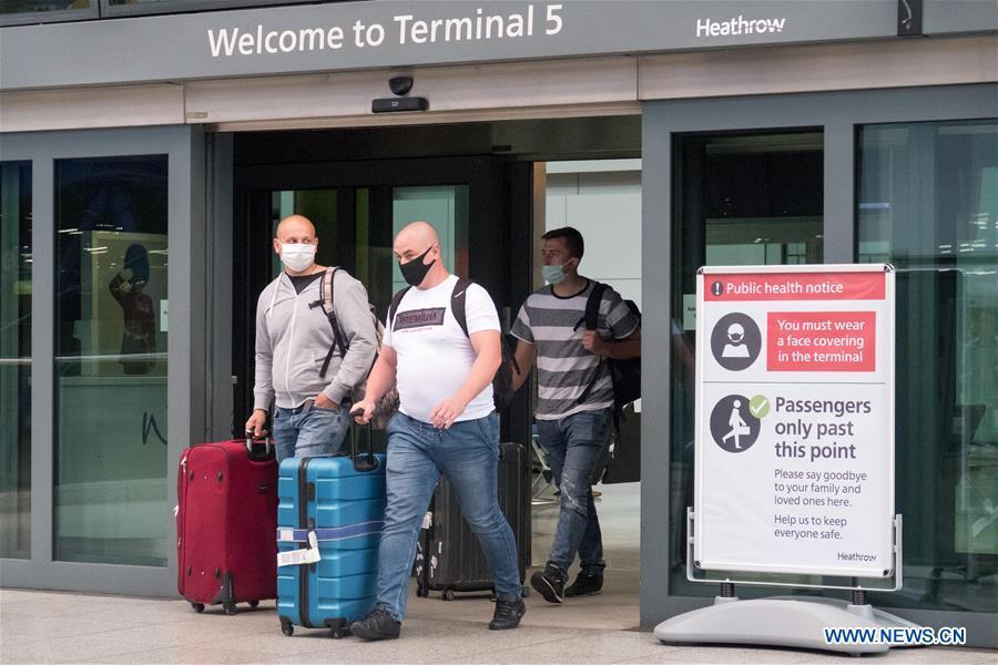 People arriving in Britain have to self-isolate for 14 days