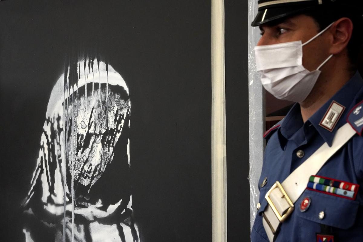 Stolen Banksy honoring Bataclan victims found in Italy