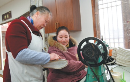 Traditional shoemaker steps up production to meet demand