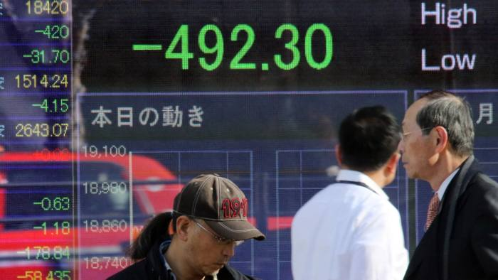 Tokyo stocks open lower on stronger yen